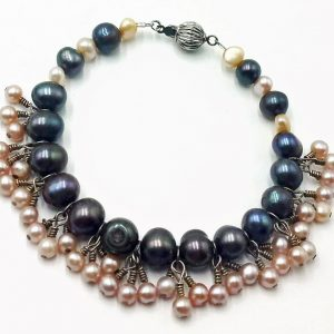 #00424. Bracelet. Sterling silver, black and white pearls, belly dancer bracelet.  White pearls move like fringe. $42