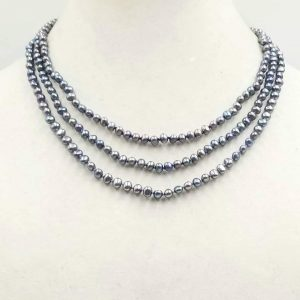 #00710. Three strand black pearl necklace with 14KYG bookclasp on twilight shades of silk.  $395